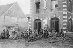German soldiers take a rest on the steps of Vareddes town hall in France, 1914